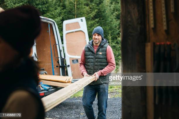 getting the work done - manual worker stock pictures, royalty-free photos & images