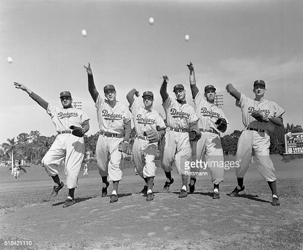 Getting their arms in shape are the righthanded members of the world champion Brooklyn Dodgers' mound staff at spring training headquarters in Vero...