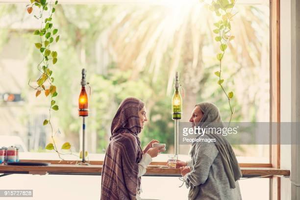 getting their coffee and girl talk fix - muslim mother stock pictures, royalty-free photos & images