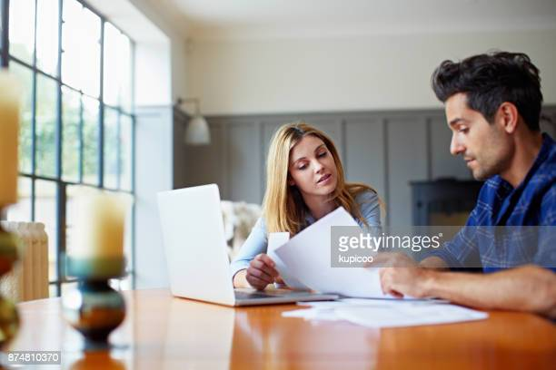 getting their household budget together - home finances stock photos and pictures