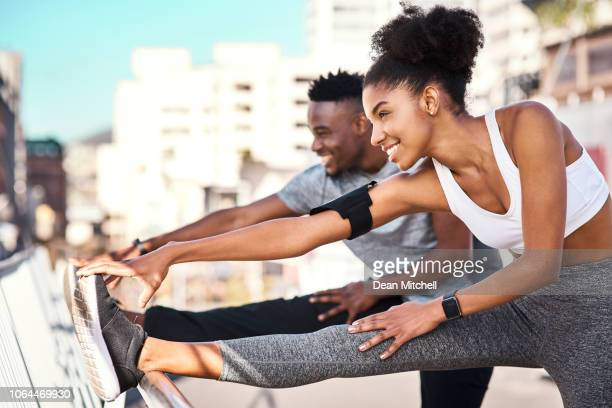 getting their stretch on - warm up exercise stock pictures, royalty-free photos & images