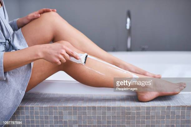 getting those legs ready for summer - female body hair stock photos and pictures