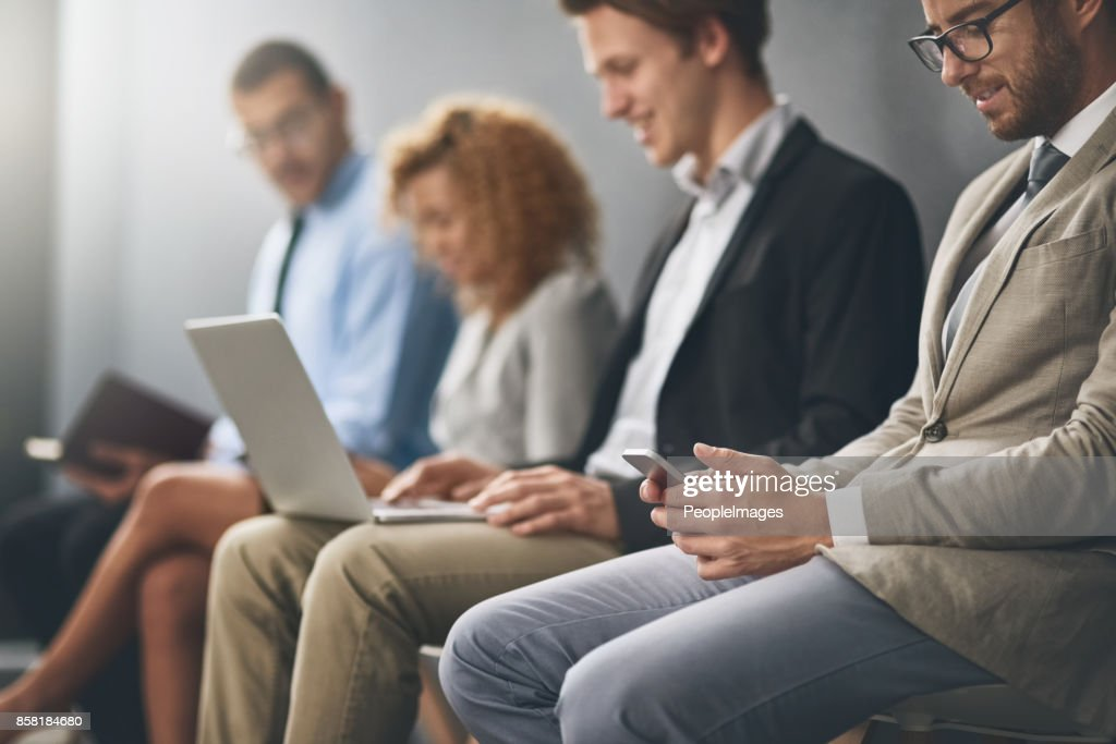 Getting through the wait for their call : Stock Photo