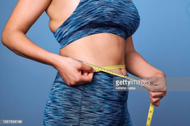 getting to the size i always wanted to be! - waist stock pictures, royalty-free photos & images