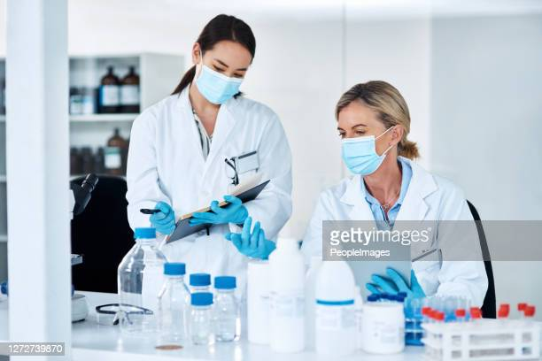 getting together for some lab work - forensicpathologist stock pictures, royalty-free photos & images