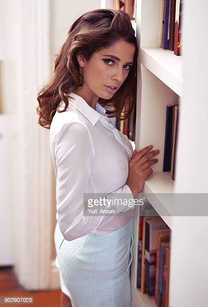 getting up close and personal with that bookshelf - women in see through tops stock photos and pictures