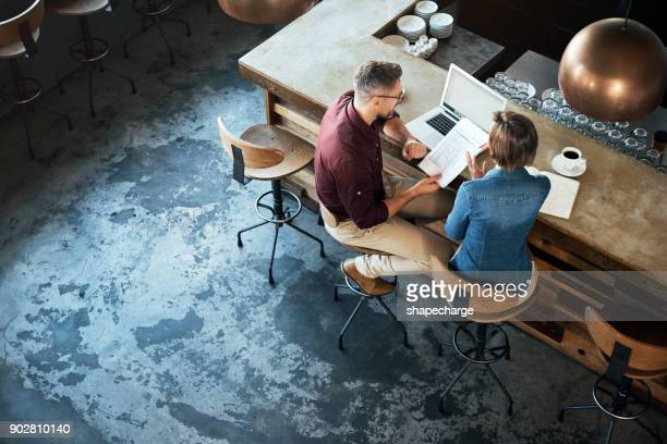 getting work done at their local coffee shop - business owner stock pictures, royalty-free photos & images