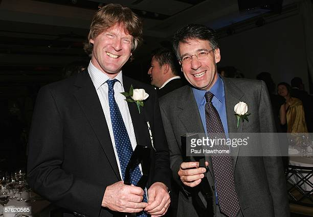 Getty Images CoFounder and Chairman Mark Getty and Getty Images CoFounder and CEO Jonathan Klein hold their ICP Trustees awards the 22nd Annual...