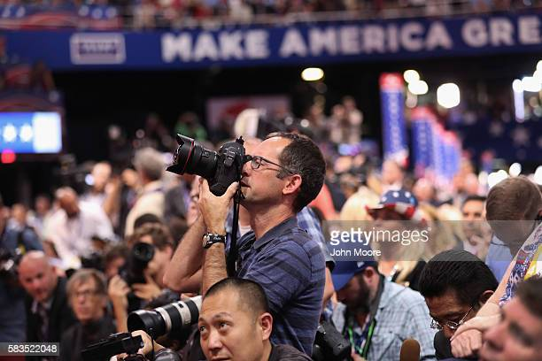 Getty Images photojournalist Chip Somodevilla photographs as Republican presidential candidate Donald Trump speaks on the fourth day of the...