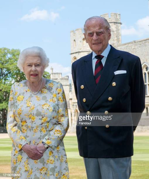 In this handout photo issued by the Press Association Queen Elizabeth II and the Duke of Edinburgh pose in the quadrangle of Windsor Castle ahead of...