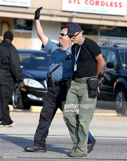 Getty Images staff photographer Scott Olson is escorted to a paddy wagon after being arrested by police as he covers the demonstration following the...