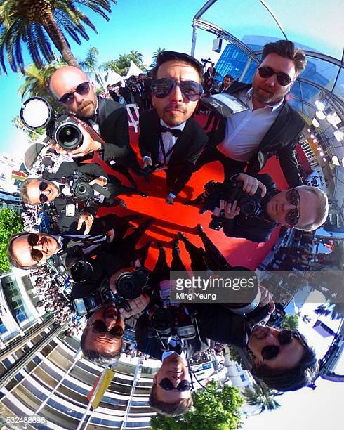 Getty Images team members wearing Carrera sunglasses during the 69th annual Cannes Film Festival at the Palais des Festivals on May 18 2016 in Cannes...