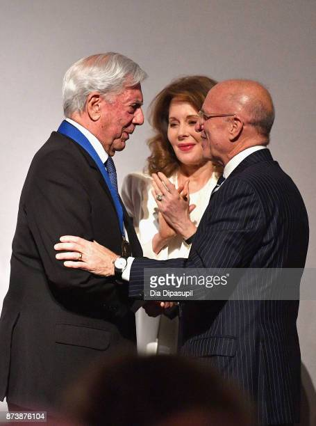 Getty Medal Award Recipient Mario Vargas Llosa Chair of the Board of Trustees of the J Paul Getty Trust Maria HummerTuttle and Jim Cuno greet onstage...