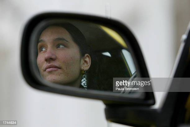 Getty Nakbeen looks out the window of the car while practicing her driving skills January 25 2003 in Kabul Afghanistan Nakbeen is one of 12...