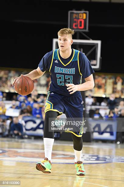 J Gettys of the North CarolinaWilmington Seahawks dribbles the ball during the Colonial Athletic Conference Championship college basketball game...