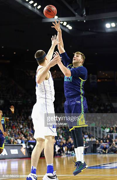 J Gettys of the North CarolinaWilmington Seahawks shoots the ball against Marshall Plumlee of the Duke Blue Devils in the first half of their game...
