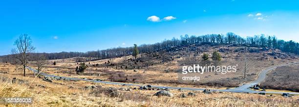 gettysburg battlefield's little round top from devil's den - gettysburg stock photos and pictures