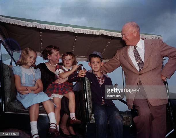 Gettysburg, PA: President and Mrs. Eisenhower with their grandchildren on Eisenhower farm. Left to right: Barbara, Mamie, Susan, David and President...