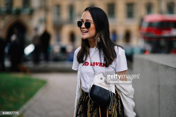 A geust wears a tshirt and a skirt outside Preen by Thornton Bregazzi during London Fashion Week September 2017 on September 17 2017 in London England
