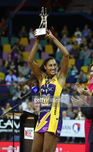 Geva Mentor captain of the Sunshine Coast Lightning holds the Suncorp Super Netball trophy aloft after winning the Super Netball Grand Final match...
