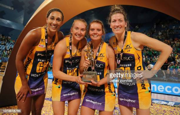 Geva Mentor Madeline Mcauliffe Kelsey Browne and Karla Pretorius of the Sunshine Coast Lightning pose for their trophy photo after their Super...