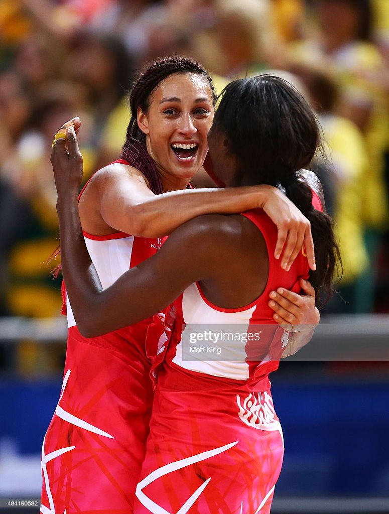 Geva Mentor of England (L) celebrates with Sonia Mkoloma of England (R) after victory in the 2015 Netball World Cup Bronze Medal match between England and Jamaica at Allphones Arena on August 16, 2015 in Sydney, Australia.