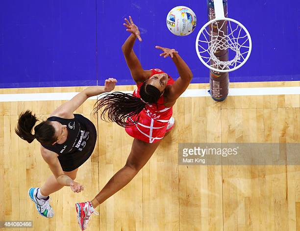 Geva Mentor of England defends against Bailey Mes of New Zealand during the 2015 Netball World Cup Semi Final 1 match between New Zealand and England...