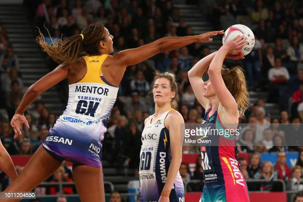Geva Mentor of the Lightning attempts to block the shot of Tegan Philip of the Vixens during the round 14 Super Netball match between the Vixens and...