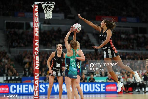 Geva Mentor of the Magpies defends as Caitlin Thwaites of the Vixens shoots during the round 14 Super Netball match between the Collingwood Magpies...