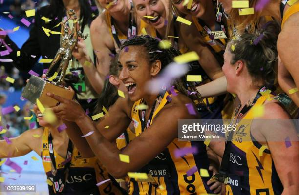 Geva Mentor of the Sunshine Coast Lightning hold the Championship trophy during the presentation Super Netball Grand Final match between the the...