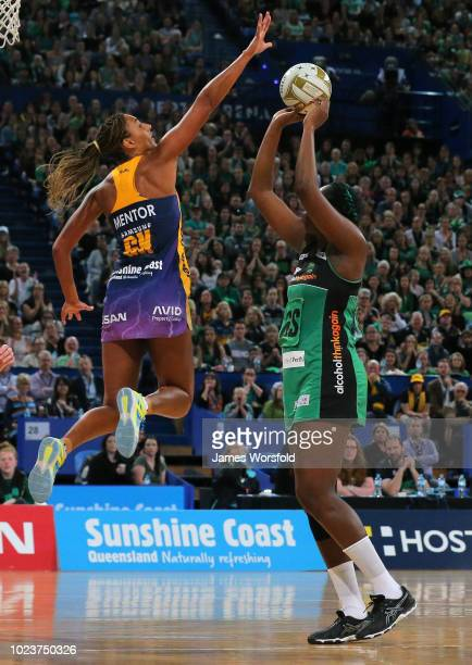 Geva Mentor of the Sunshine Coast Lightning tries to block the shot of Jhaniele Fowler of the West Coast Fever during the Super Netball Grand Final...