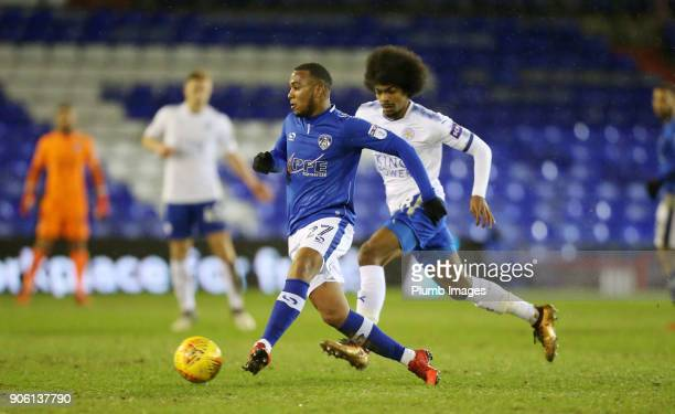 Gevaro Nepomuceno of Oldham Athletic in action with Hamza Choudhury of Leicester City during the Checkatrade Trophy tie between Oldham Athletic and...