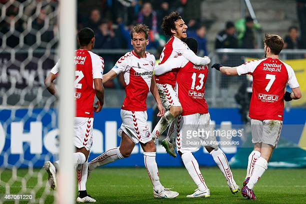 Gevero Markiet of Utrecht is congratulated by team mates after scoring a goal during the Dutch Eredivisie match between FC Utrecht and NAC Breda held...
