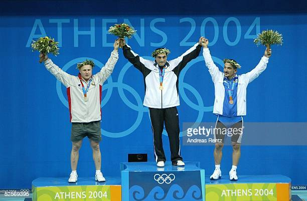 Gewichtheben Olympische Spiele Athen 2004 Athen 7785kg / Maenner Silber Andrei RYBAKOU / BLR Gold George ASANIDZE / GEO Bronze Pyrros DIMAS / GRE...