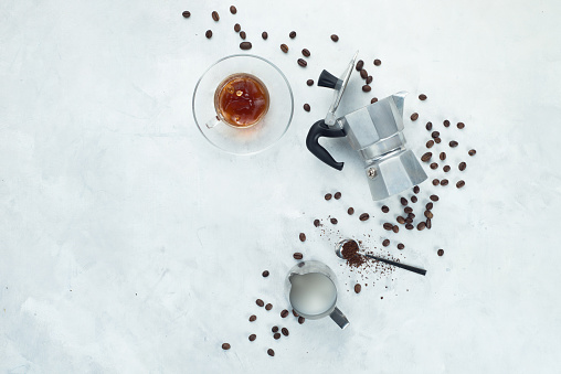 Geyser coffee maker in a minimalist flat lay with espresso cup, milk and coffee beans.... - gettyimageskorea