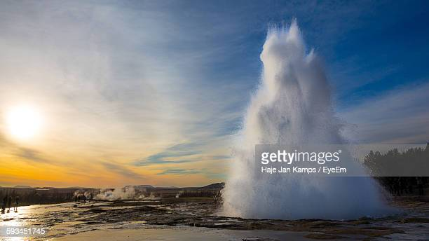 Geyser On Field Against Sky During Sunset