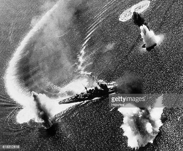 Geysers erupt in the water around a frantically maneuvering Japanese heavy cruiser as Navy carrierbased bombers plaster Manila Bay The cruiser soon...