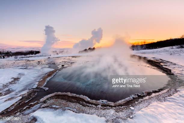geysir winter - island stock-fotos und bilder