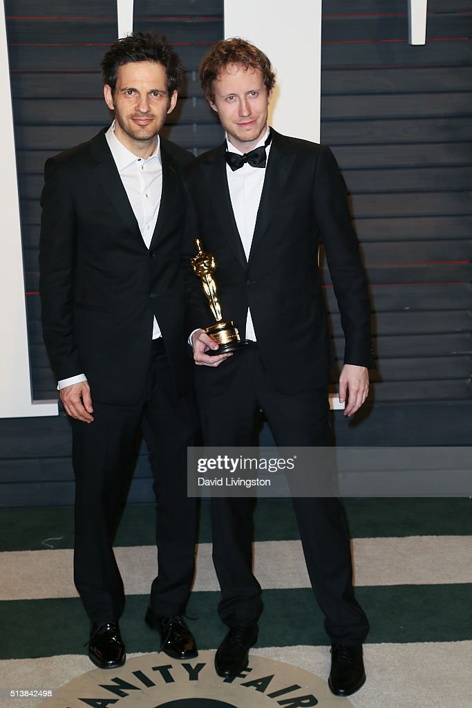 Geza Rphrig (L) and Laszlo Nemes arrive at the 2016 Vanity Fair Oscar Party Hosted by Graydon Carter at the Wallis Annenberg Center for the Performing Arts on February 28, 2016 in Beverly Hills, California.