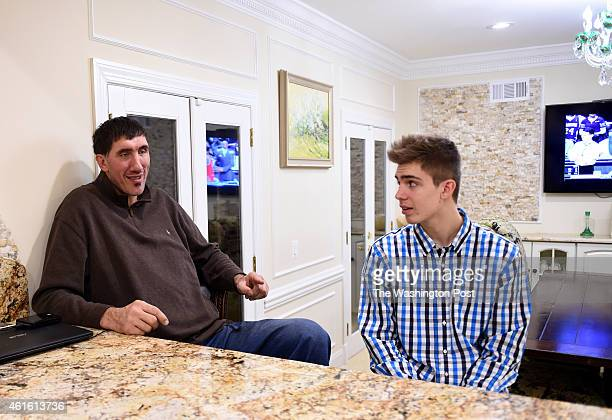 GFormer Washington Bullets center Gheorghe Muresan talks with his son, George, at home on January 8, 2015 in Potomac, MD.