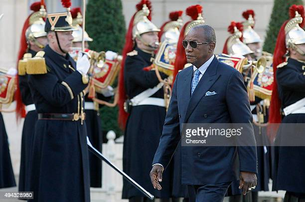 GGuinea's President Alpha Conde walks past Republican Guards as he arrives before his meeting with French President Francois Hollande at the Elysee...