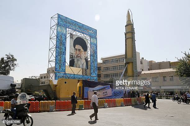 A GhadrF missile is displayed next to a portrait of Iran's Supreme Leader Ayatollah Ali Khamenei at a war exhibition to commemorate the 198088...
