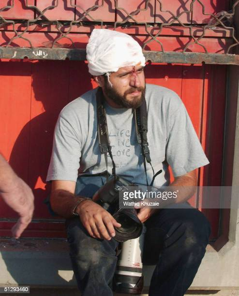 Ghaith Abdul Ahad a freelance photographer working for Getty Images takes rest after he was injured while covering clashes on September 12 2004 in...