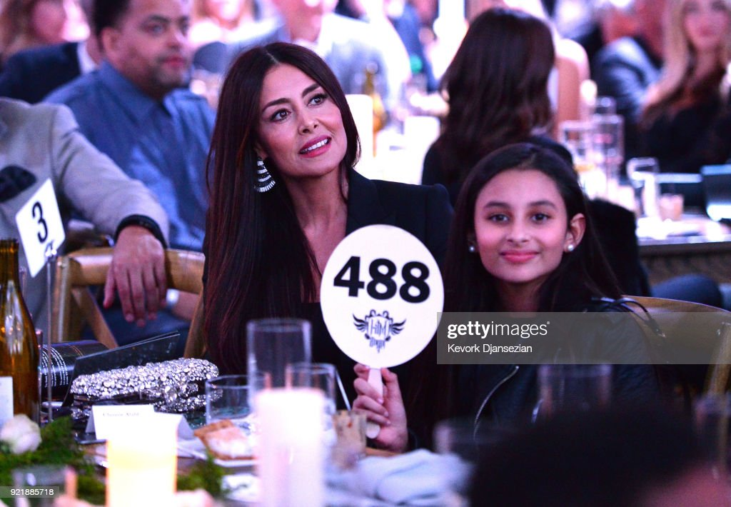 Ghamzeh 'Christie' Alabbar (L) and Noor Alabbar bid at will.i.am's i.am.angel Foundation TRANS4M 2018 Gala, Honoring Sean Parker, Chairman, Parker Institute for Cancer Immunotherapy at Milk Studios on February 20, 2018 in Hollywood, California.