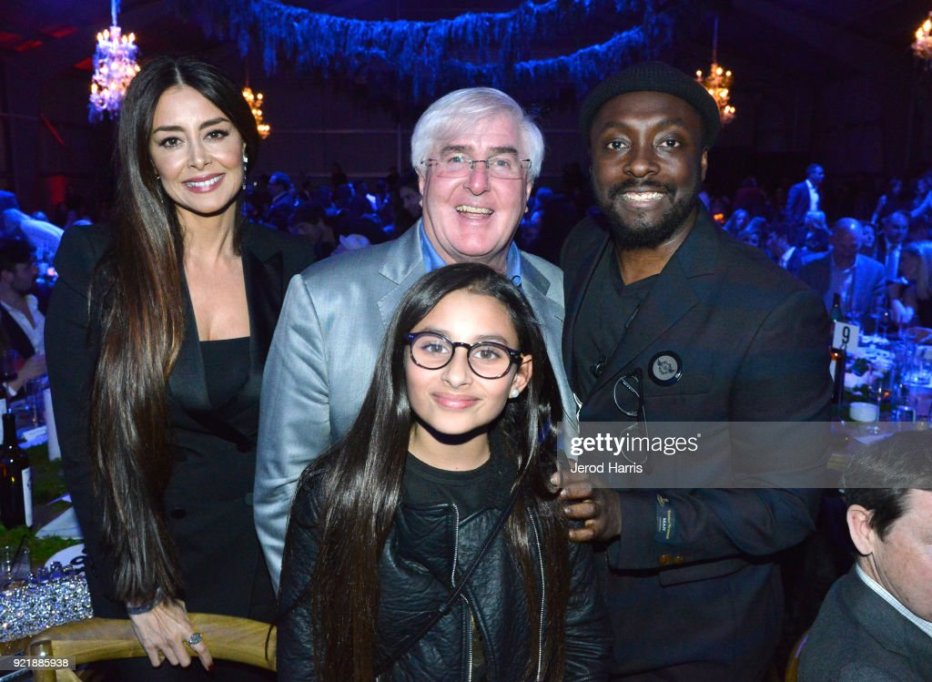 Ghamzeh 'Christie' Alabbar, Ron Conway, will.i.am, and Noor Alabbar at will.i.am's i.am.angel Foundation TRANS4M 2018 Gala, Honoring Sean Parker, Chairman, Parker Institute for Cancer Immunotherapy at Milk Studios on February 20, 2018 in Hollywood, California.