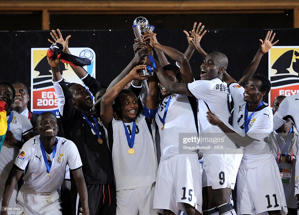 Ghana captain Andre Ayew holds up the trophy with team-mates during the FIFA U20 World Final match between Ghana and Brazil at the Cairo International Stadium on October 16, 2009 in Cairo, Egypt.