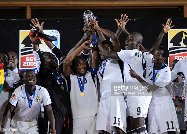 Ghana captain Andre Ayew holds up the trophy with teammates during the FIFA U20 World Final match between Ghana and Brazil at the Cairo International...