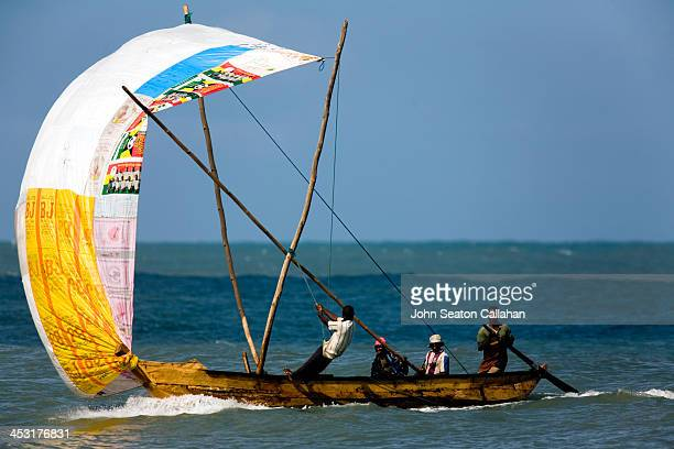 Ghana, Central Province, fishermen in sailing boat. Local fishermen use the afternoon onshore wind to return to port.