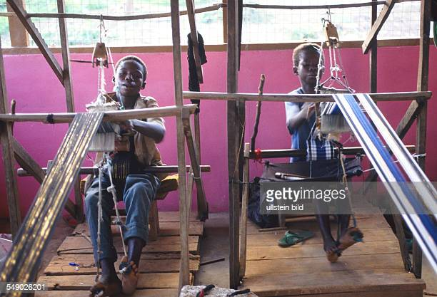 Children weaving Kente cloth near Kumasi
