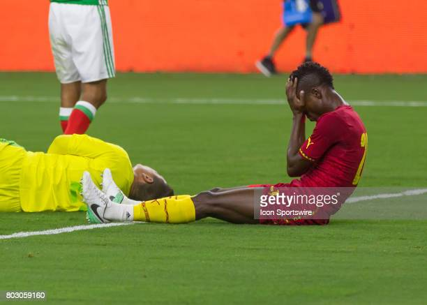 Ghana defender John Boye holds his head after colliding with Mexico goalkeeper Moises Muñoz in fight for ball during the Mexico vs Ghana friendly...